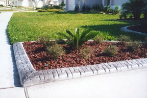 Edge your driveway like this to retain your decorative mulch.