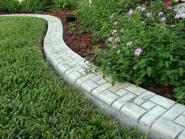 Kwik kerb eurostyle stamped and colored concrete curbing for Decorative stone garden border